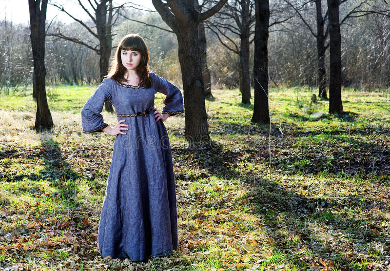 Young Woman In Vintage Dress In The Forest Stock Photography