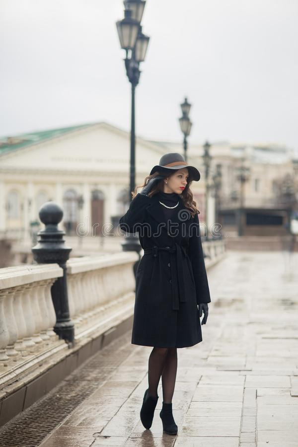 Young woman iin Moscow centre. Young woman in vintage style walking near Moscow Manege at winter day stock images