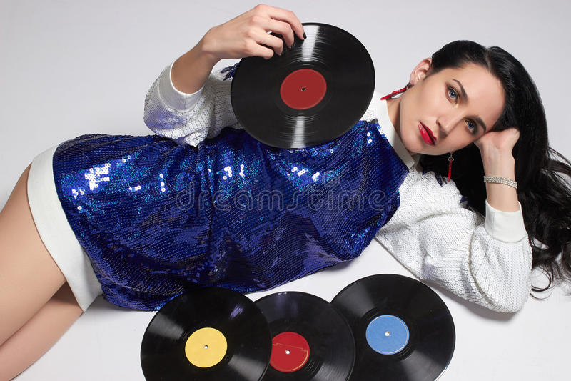 Young woman with vinyl disc. Fashion portrait of Young woman with vinyl disc.Retro Disco girl.pop Star royalty free stock images