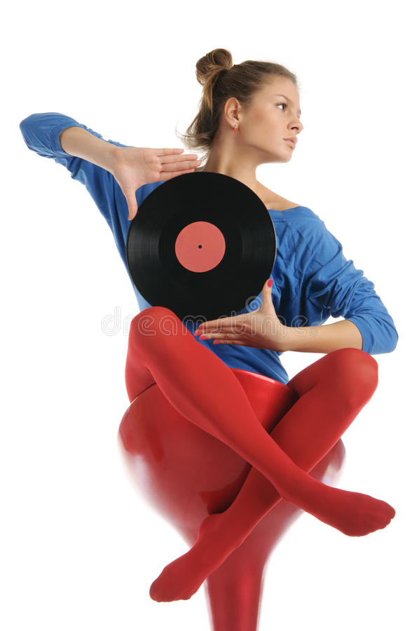 Young woman with vinyl record royalty free stock photo