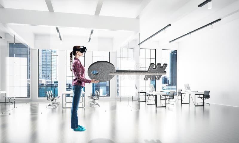 Girl in virtual reality mask experiencing virtual technology world. Mixed media royalty free stock photos
