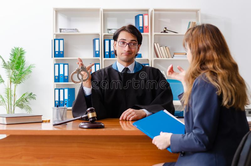 The young woman visiting male lawyer royalty free stock images