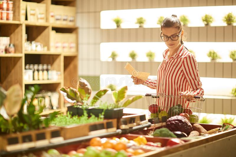Woman in supermarket stock photos