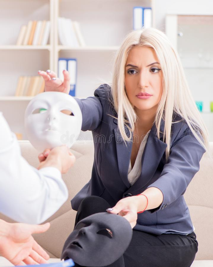 Young woman visiting psychiatrist man doctor for consultation. The young women visiting psychiatrist men doctor for consultation stock photography