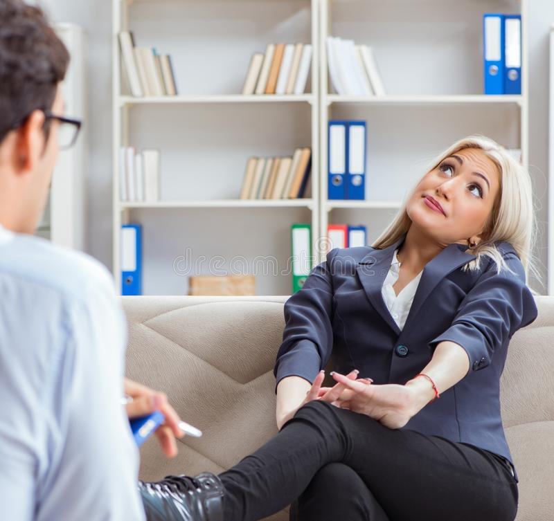 Young woman visiting psychiatrist man doctor for consultation. The young women visiting psychiatrist men doctor for consultation stock photos