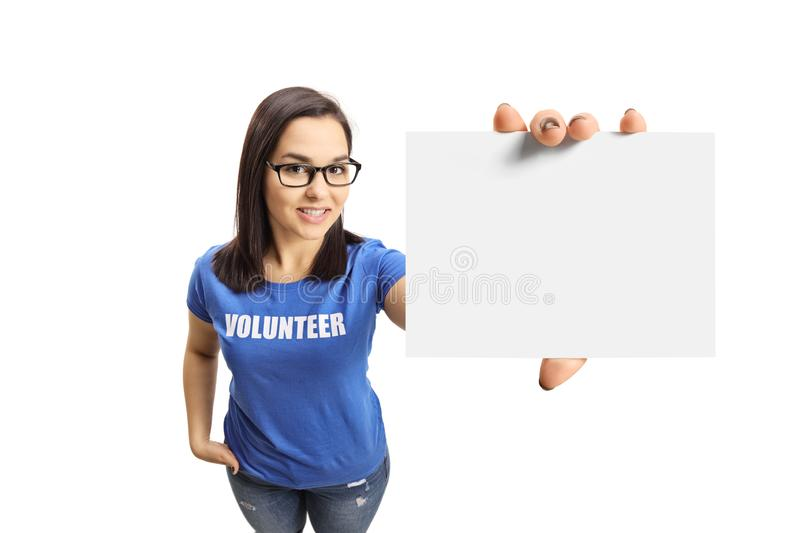 Young woman volunteer with a blank card. Isolated on white background stock photography