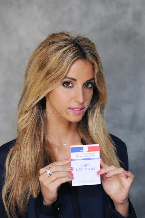Young woman. With vote card stock image