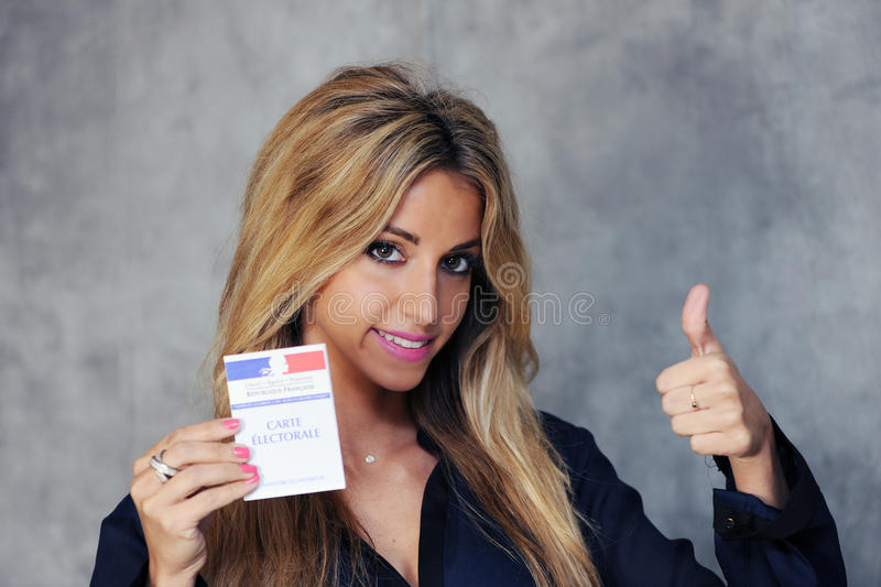 Young woman. With vote card stock photos