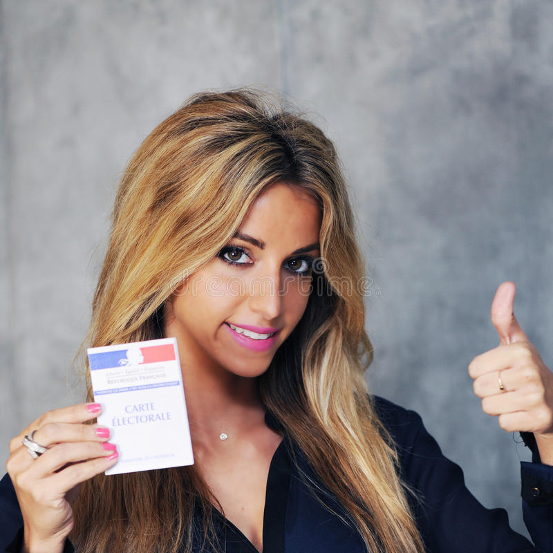 Young woman. With vote card stock photo