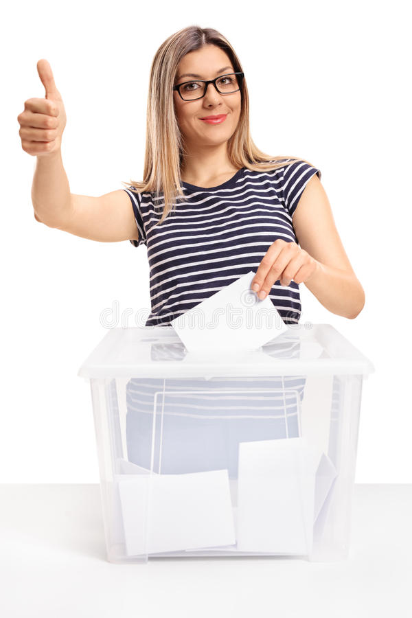 Young woman voting and making a thumb up gesture. Isolated on white background royalty free stock images