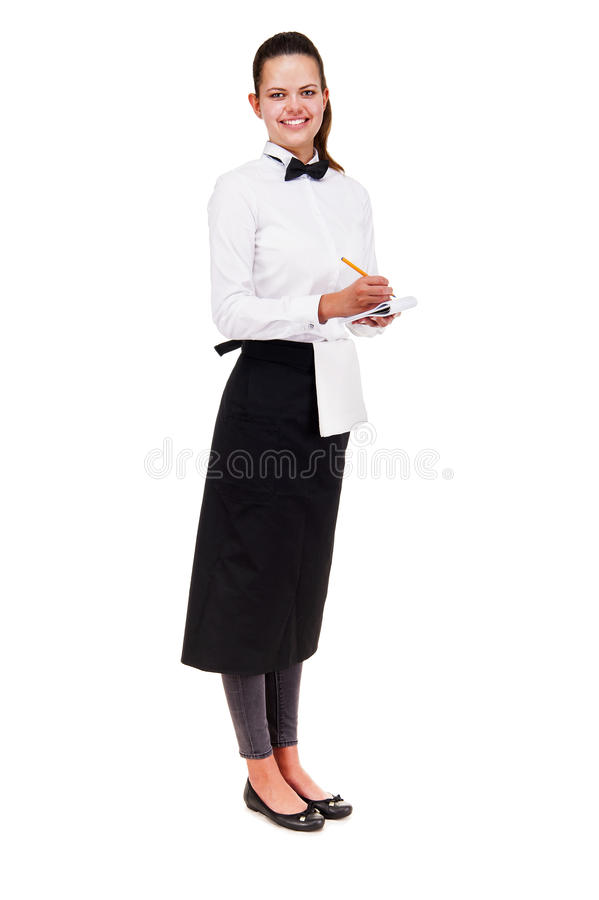 Young woman in waiter uniform holding notepad over white background isolated. stock photography