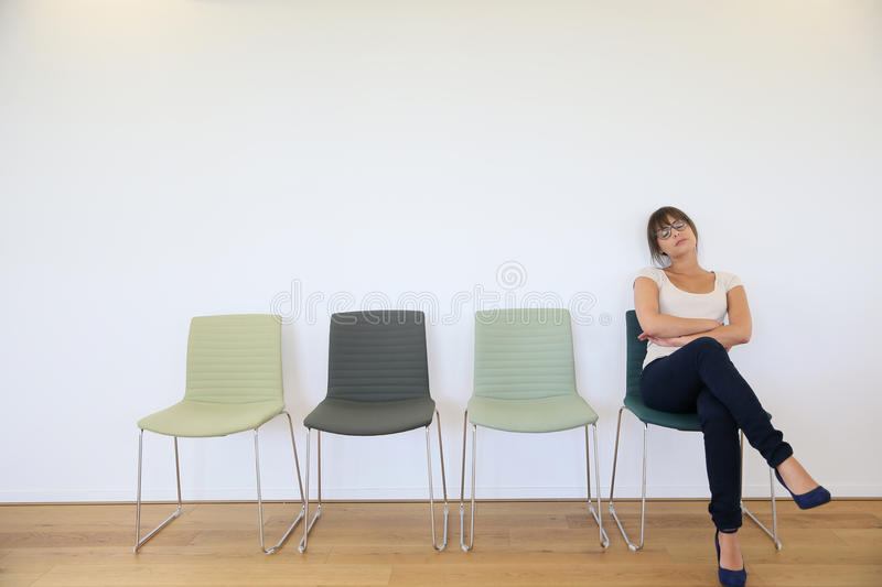 Young woman in waiting room stock photos