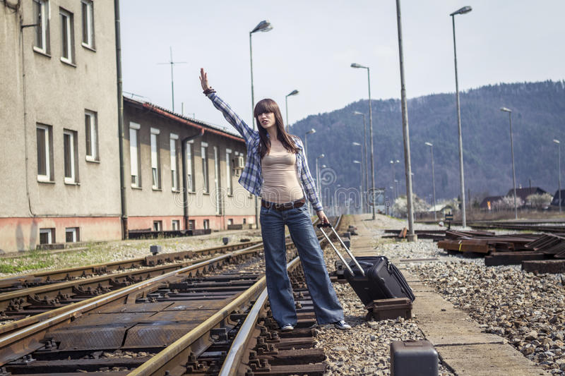 Young woman waiting for the train stock photo