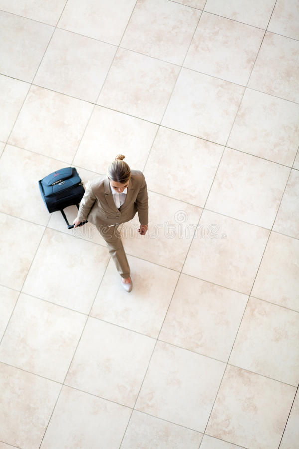 Young woman walking at airport royalty free stock image