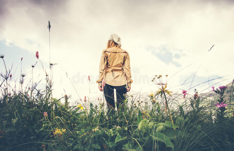 Young Woman walking alone Travel Lifestyle concept. Summer vacations outdoor rocky mountains on background view from the ground stock image