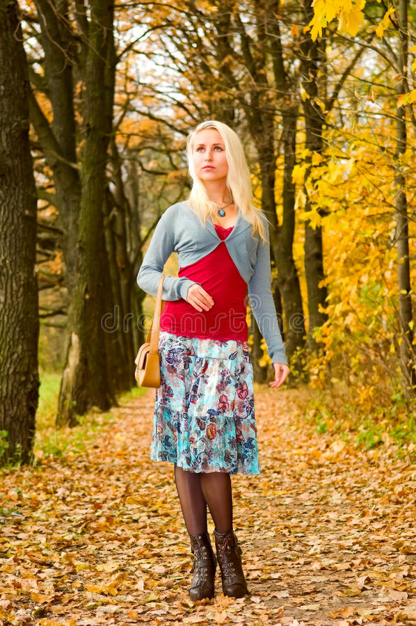 Young Woman Walking In Autumn Park Stock Images