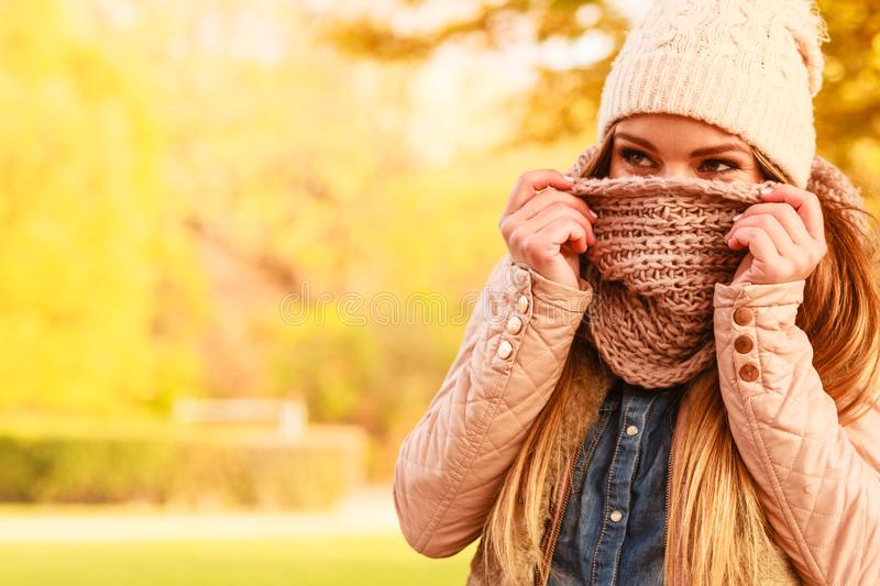 Girl hiding her face with scarf royalty free stock image