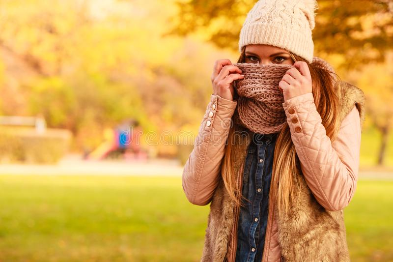 Girl hiding her face with scarf stock photos