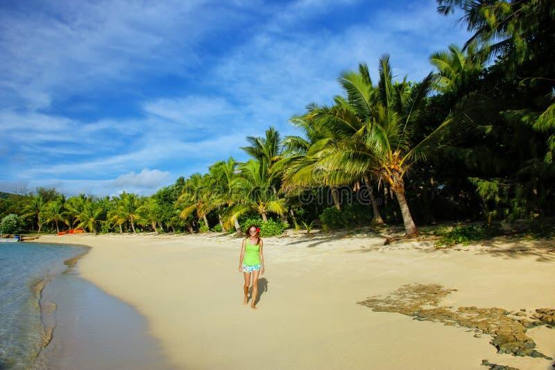 Young woman walking on a beach on Drawaqa Island, Yasawa Islands, Fiji stock photography