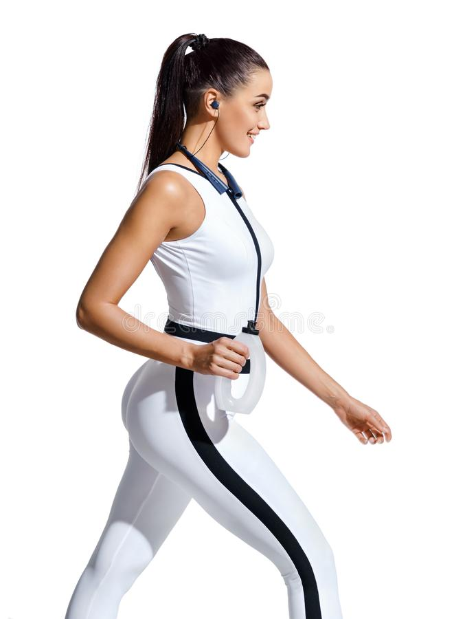 Young woman walking with bottle of water in silhouette on white background royalty free stock photos