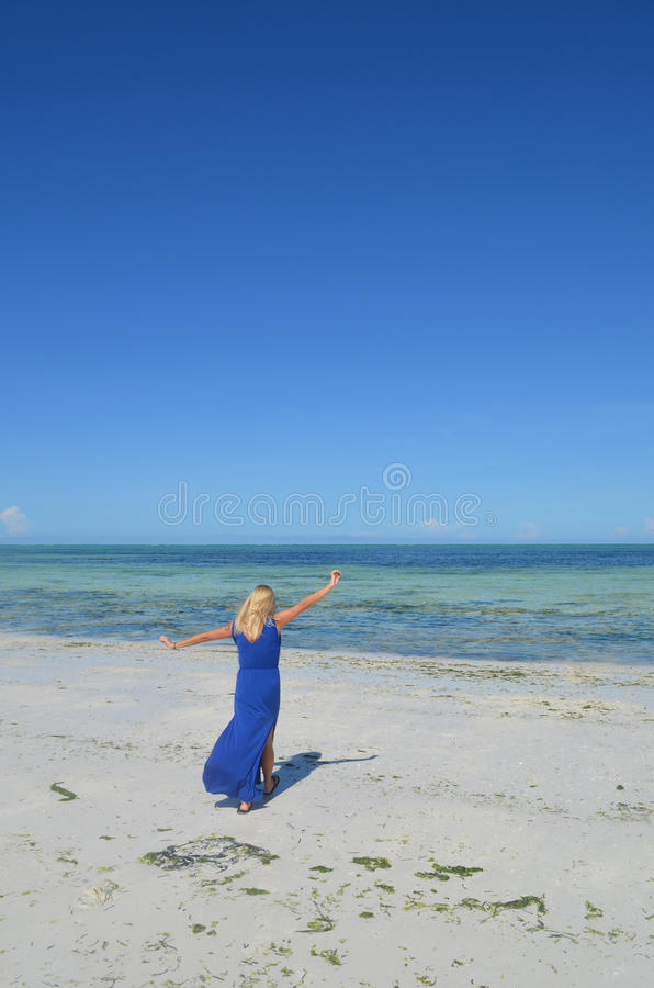 Download Young Woman Walking On An Exotic Beach. Stock Image - Image: 37474431