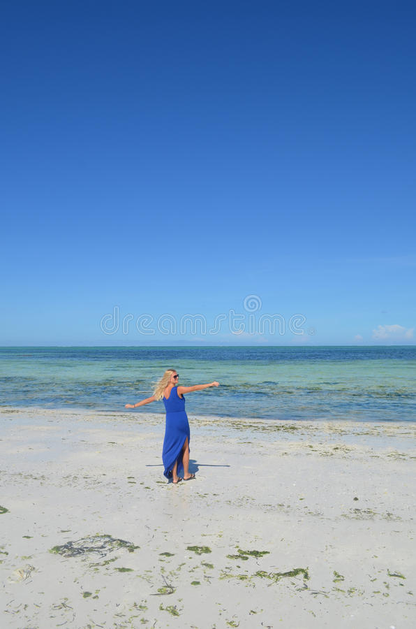 Download Young Woman Walking On An Exotic Beach. Stock Image - Image: 37474433
