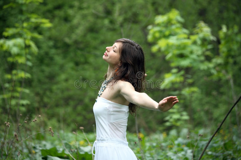 Young woman walking in a forest royalty free stock image