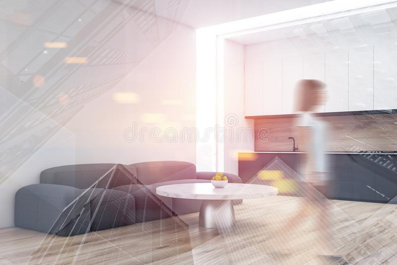 Woman walking in living room and kitchen royalty free stock images