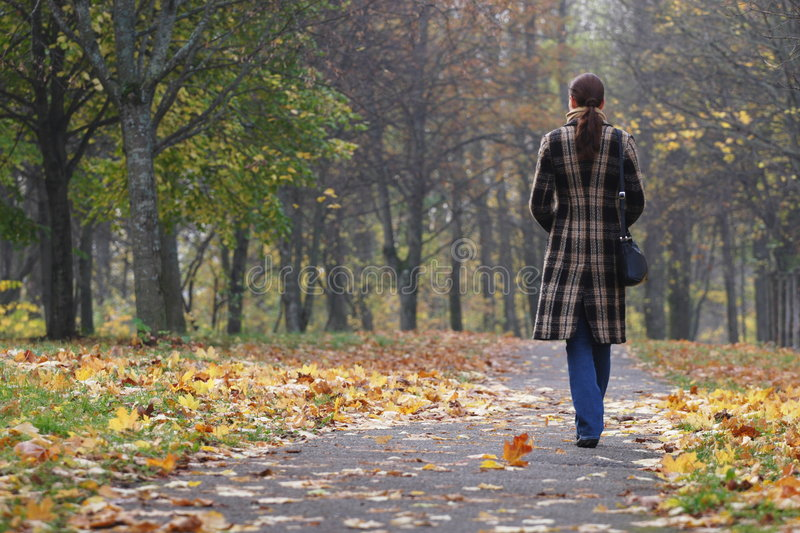 Young woman walking in park stock image