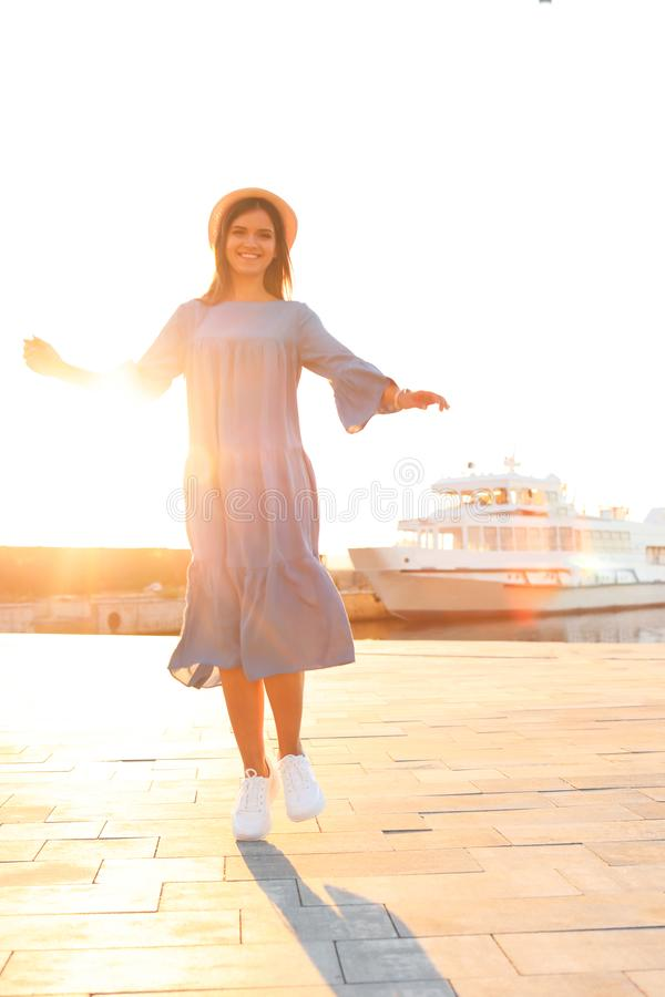 Young woman walking on pier royalty free stock image
