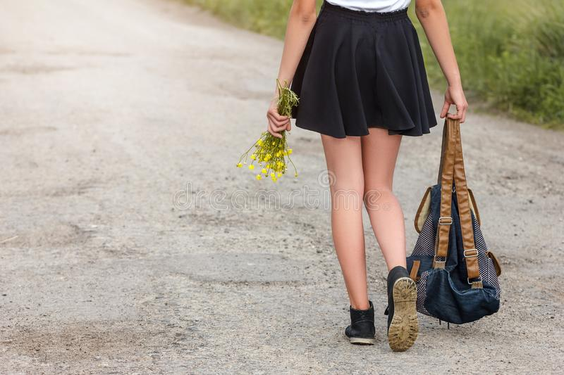 Young woman walking on the road with backpack travel concept royalty free stock photography