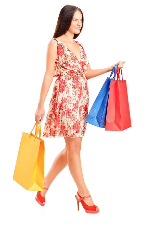 Download Young Woman Walking With Shopping Bags Stock Image - Image: 26636599