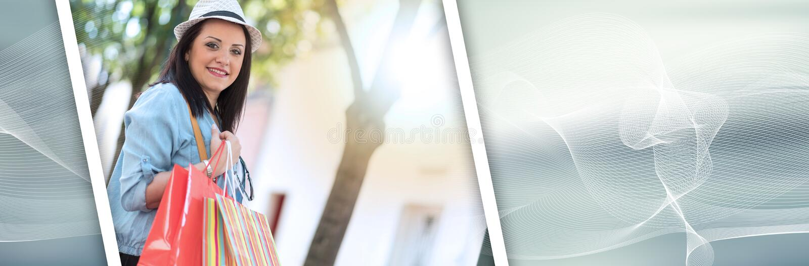 Young woman walking with shopping bags in hand, light effect. panoramic banner royalty free stock photography