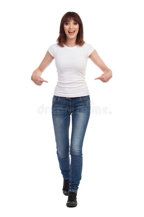 Young Woman Is Walking Towards Camera, Pointing At Her ...