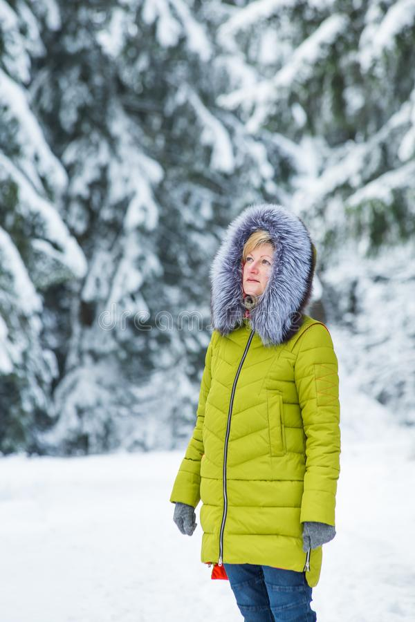 A young woman is walking through the winter forest stock photos