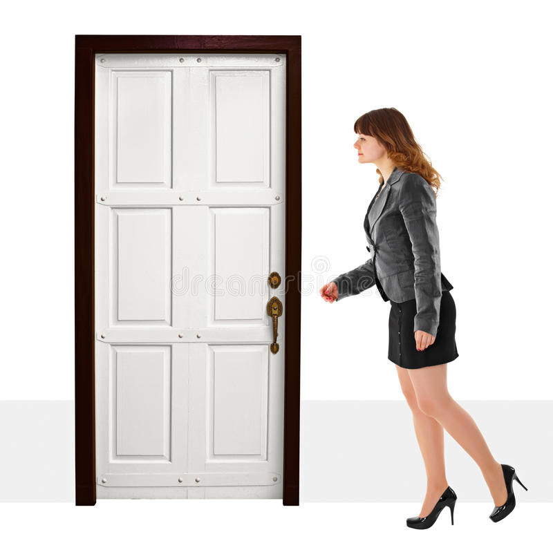 A young woman walks into door royalty free stock images