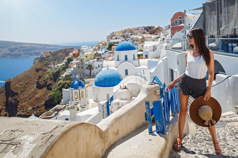 Young woman walks on  Santorini stock images