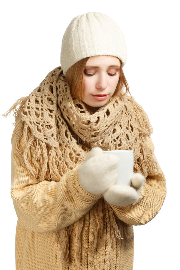 Young woman in warm clothing with mug. Young woman in warm winter clothing with mug isolated on white background stock photos