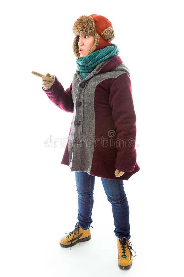 Download Young Woman In Warm Clothing And Showing Something Stock Photo - Image: 41945388