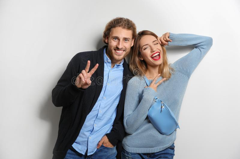 Young woman in warm sweater and man wearing knitted cardigan royalty free stock images