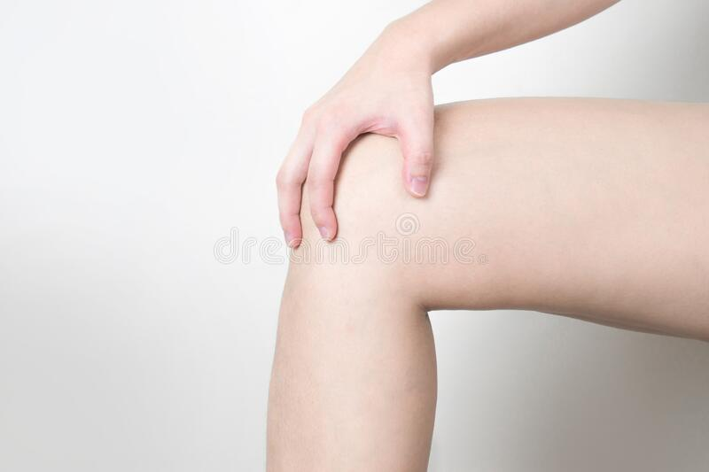 The young woman was feeling knee pain royalty free stock photos