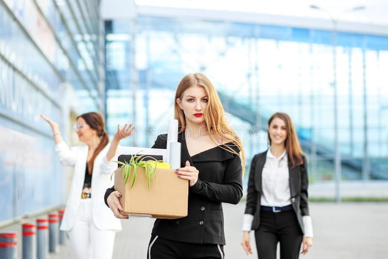 The young woman was fired from the corporation. The end of a career. Concept for business, unemployment, labor exchange and royalty free stock photography