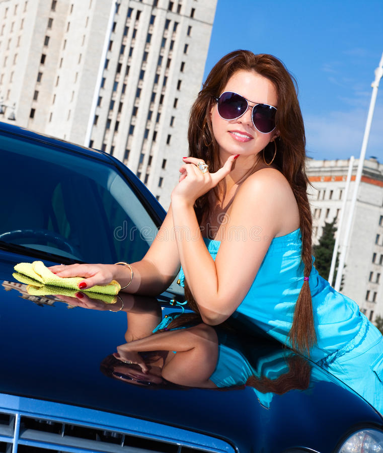 Young woman washing car royalty free stock image