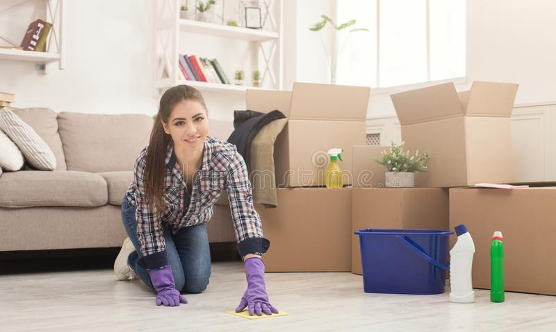 Young woman cleaning home with mop royalty free stock images
