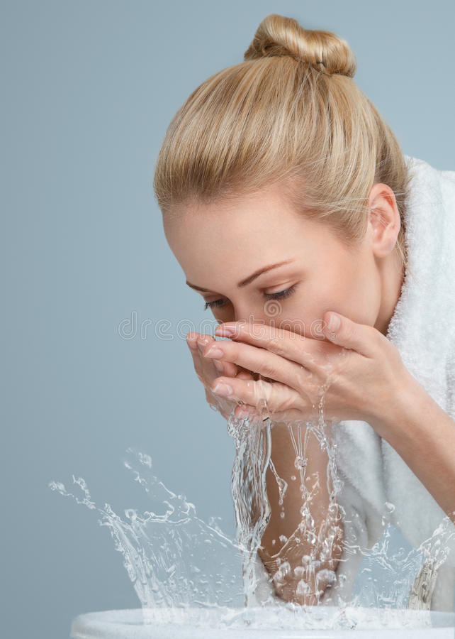 Free Young Woman Washing Her Face Royalty Free Stock Photo - 30346215