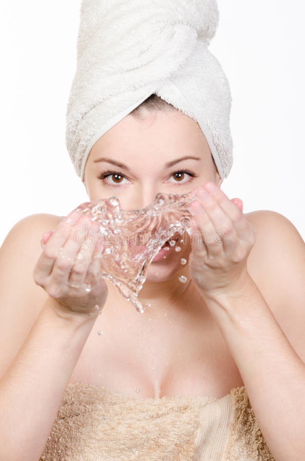 Young woman washing her face with water stock photos