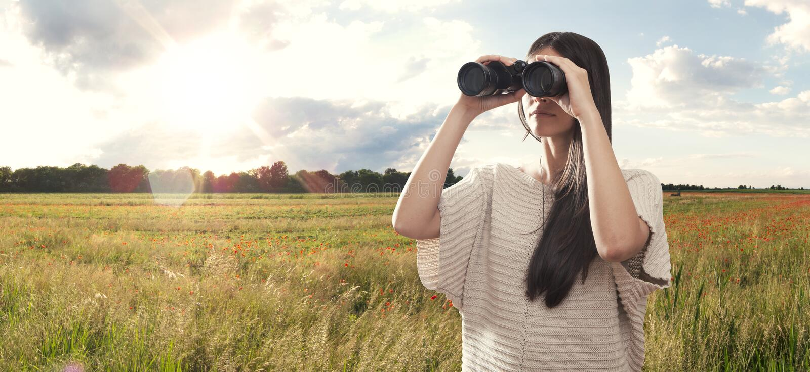 Young woman watching with binocular royalty free stock images