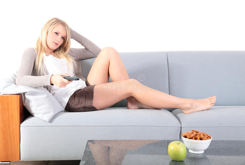 Young woman watching tv stock photo