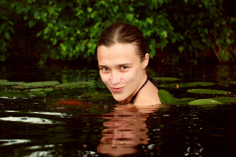 Young woman in water stock image