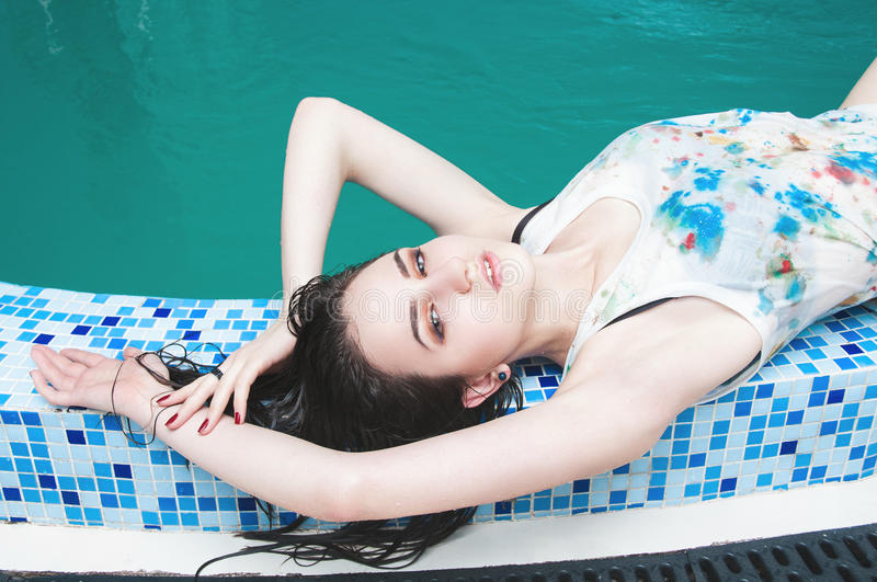 Young woman in the water pool. Young woman relaxing in the water royalty free stock image